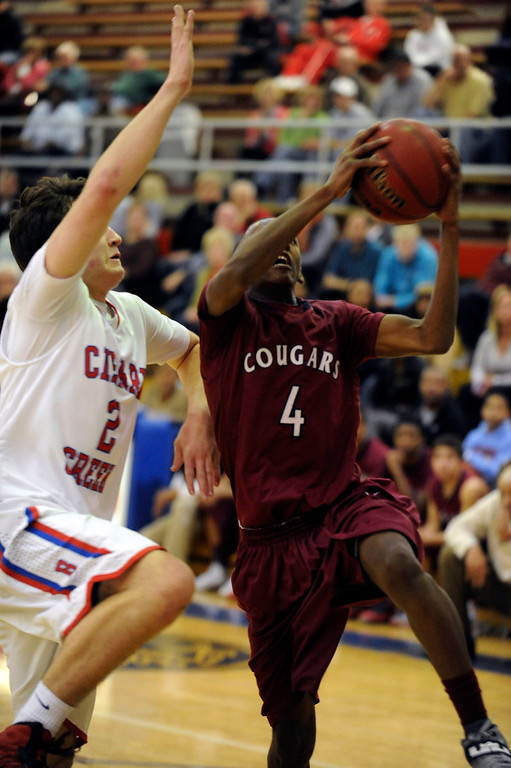 . GREENWOOD VILLAGE, CO. - FEBRUARY 6: Griffin Parr of Cherry Creek defends the drive to the basket by Cherokee Trail\'s Tyler Larkin in the fourth quarter Wednesday night at Cherry Creek High School. Larkin scored to extend the Cougar lead late in the game. (Photo by Steve Nehf, The Denver Post)