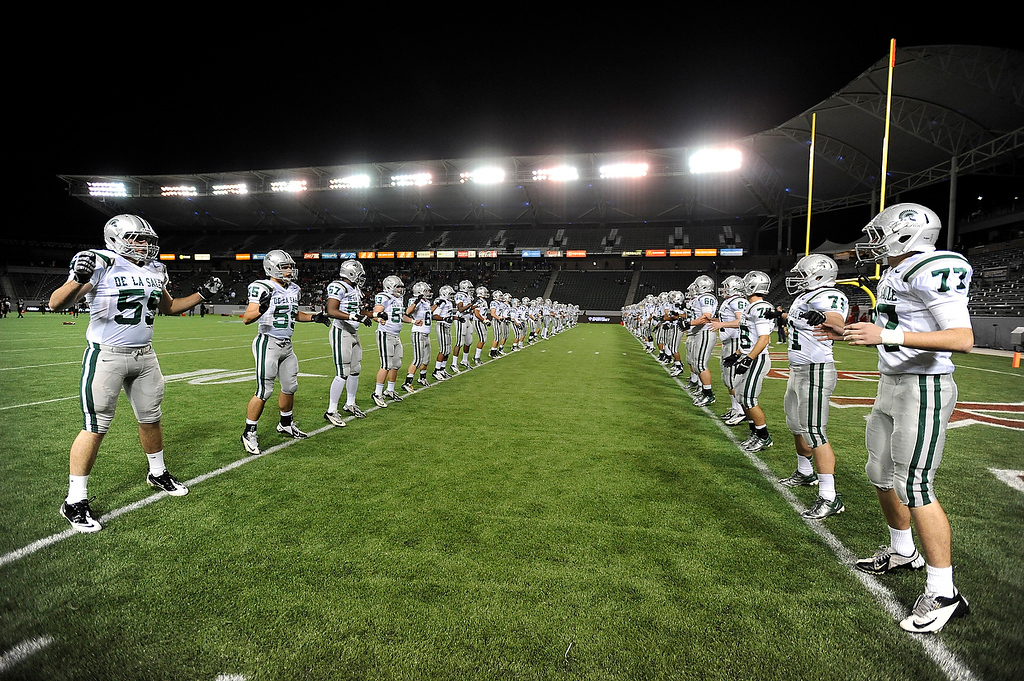 . De La Salle Spartans warm up on the field before playing the Centennial Huskies in the Open Division during the 2012 CIF State Football Championship at Home Depot Center in Carson , Calif. on Saturday, Dec. 15, 2012. (Jose Carlos Fajardo/Staff)