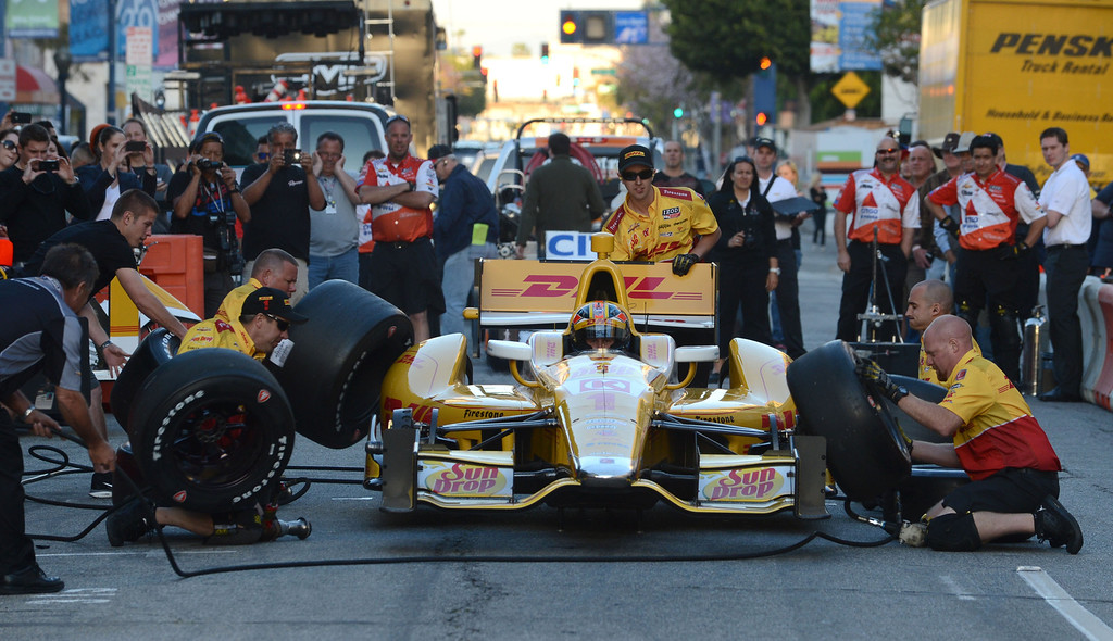 . Long Beach, Calif., -- 04-18-13- IndyCar driver Ryan Hunter-Reay and his pit crew compete in a pit competition along Broadway and Pine Ave. during the Tecate Light Thunder Thursday On Pine.  Race fans were able to get a close up look at race cars, meet drivers and see and IndyCar pit demonstration.   Stephen Carr/  Los Angeles Newspaper Group