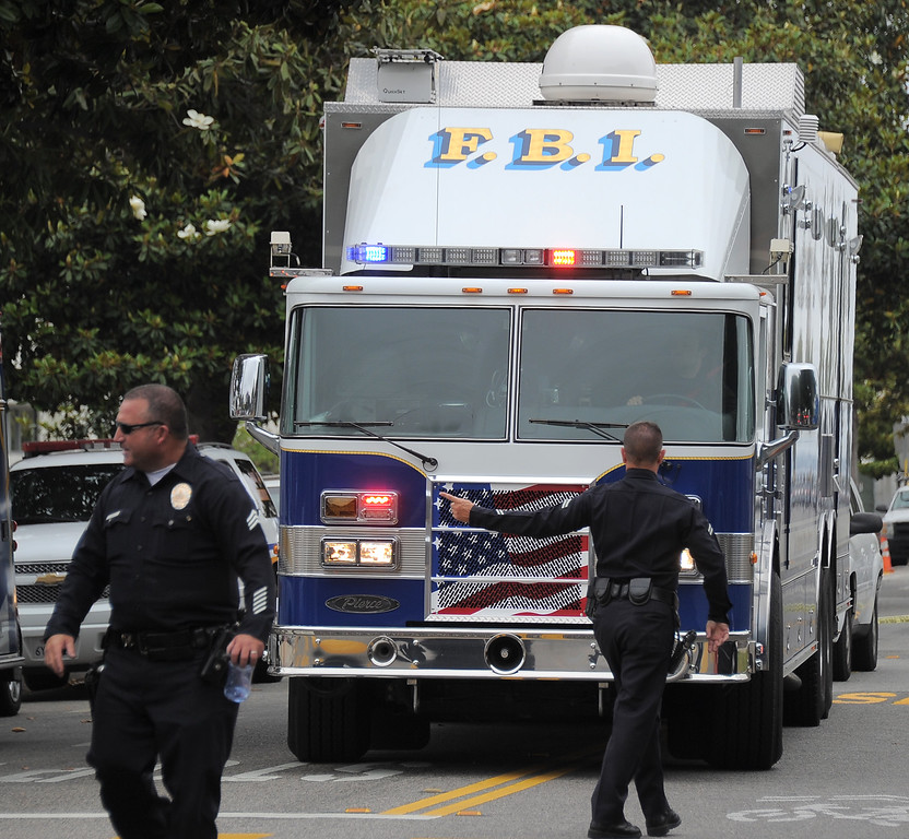 . An FBI Mobile Command Center vehicle enters the grounds of Santa Monica College after multiple shootings were reported on the campus June 7, 2013 in Santa Monica, California.  At least six people died in the shooting rampage before police shot and killed a black-clad gunman in the college library, police said.   (JOE KLAMAR/AFP/Getty Images)