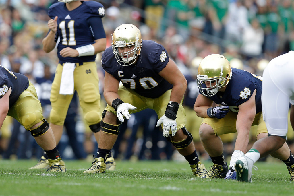 . Notre Dame offensive tackle Zack Martin (70) lines up against Michigan State during the first half of an NCAA college football game in South Bend, Ind., Saturday, Sept. 21, 2013. (AP Photo/Michael Conroy)