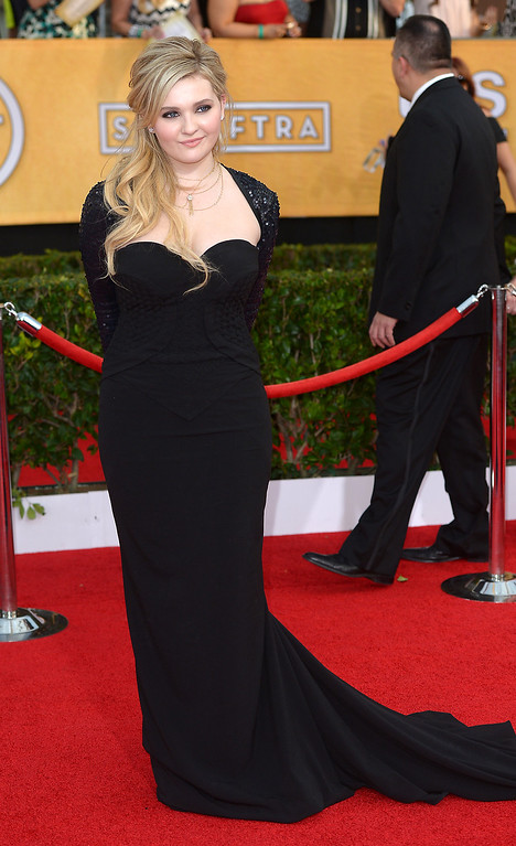 . Abigail Breslin arrives at the 20th Annual Screen Actors Guild Awards  at the Shrine Auditorium in Los Angeles, California on Saturday January 18, 2014 (Photo by Michael Owen Baker / Los Angeles Daily News)