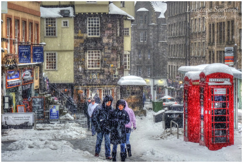 Snow falling on the Royal Mile