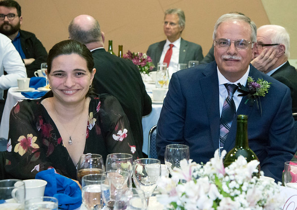 11/21/19 Wesley Bunnell | StaffrrThe Greater New Britain Chamber of Commerce celebrated their 106th year with their annual dinner on Friday night at CCSU. Candace DiCosimo, L, and father and business owner Jeff DiCosimo accepted the award for Plainville Business of the Year fo Premier Portraits.