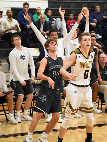 Bloomfield Hills Cranbrook-Kingswood senior Alex Finney (14) watches his 3-point shot go in during the fourth quarter Friday night against Madison Heights Bishop Foley. (Digital First Media photo by Jason Schmitt)