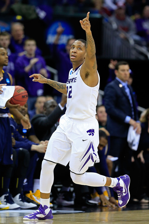 . KANSAS CITY, MO - MARCH 22:  Rodney McGruder #22 of the Kansas State Wildcats reacts against the La Salle Explorers in the second half during the second round of the 2013 NCAA Men\'s Basketball Tournament at the Sprint Center on March 22, 2013 in Kansas City, Missouri.  (Photo by Jamie Squire/Getty Images)