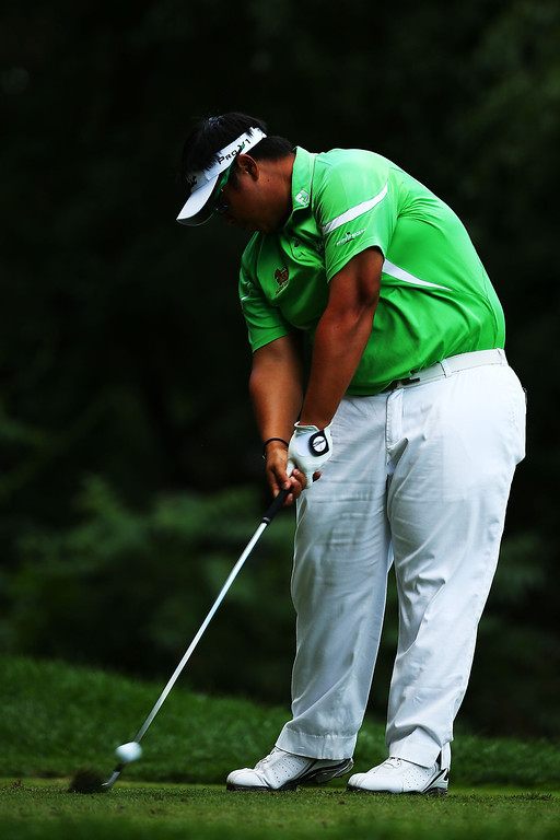 . Kiradech Aphibarnrat of Thailand hits his tee shot on the third hole during the final round of the 95th PGA Championship on August 11, 2013 in Rochester, New York.  (Photo by Streeter Lecka/Getty Images)