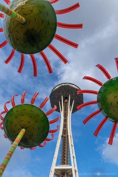 "Space Needle seen thru ""Sonic Bloom"" - giant solar-powered flower sculpture."