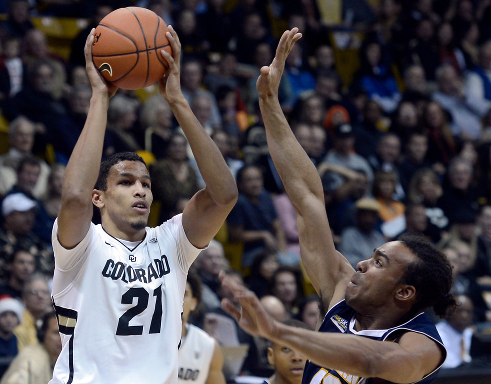 . University of Colorado\'s Andre Roberson shoots a three-pointer over Ben Olayinka during a game against Northern Arizona on Friday, Dec. 21, at the Coors Event Center on the CU campus in Boulder.   (Jeremy Papasso/Daily Camera)