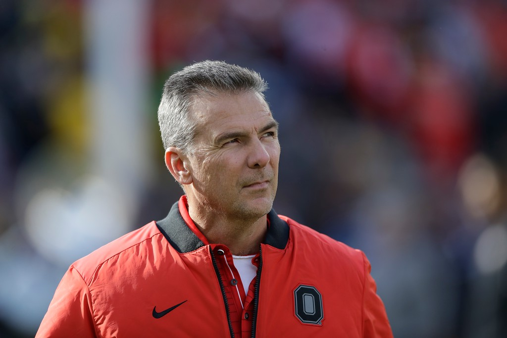 . Ohio State head coach Urban Meyer walks on the field during warmups an NCAA college football game against Michigan, Saturday, Nov. 25, 2017, in Ann Arbor, Mich. (AP Photo/Carlos Osorio)