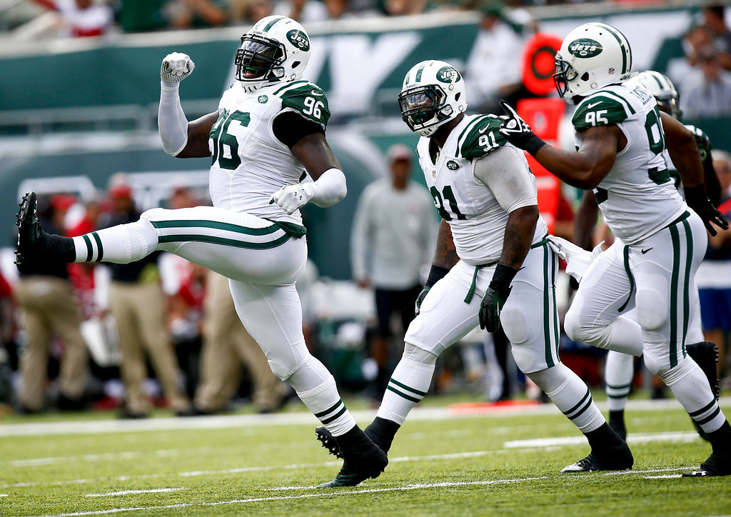 . Muhammad Wilkerson #96 of the New York Jets celebrates a sack of Josh Freeman #5 of the Tampa Bay Buccaneers (not pictured)during their game at MetLife Stadium on September 8, 2013 in East Rutherford, New Jersey.  (Photo by Jeff Zelevansky/Getty Images)