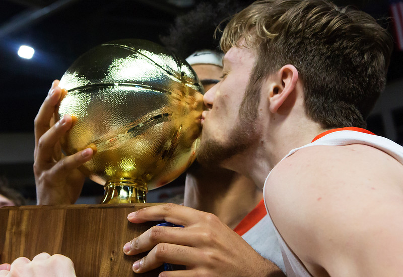 BANGOR, Maine -- 03/04/2017 -- Machias' James Mersereau gives the golden ball a kiss after defeating Greenville during their Class D boys basketball state championship at the Cross Insurance Center in Bangor Saturday. Ashley L. Conti | BDN