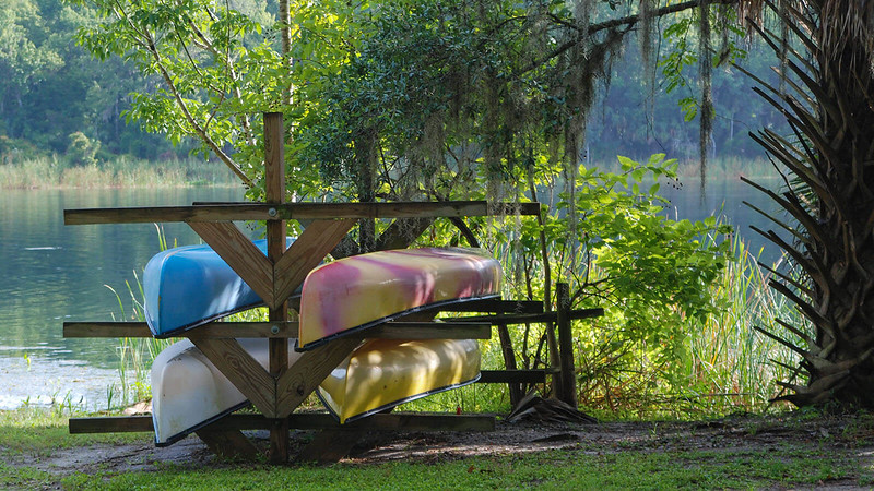 Colorful kayaks on a rack