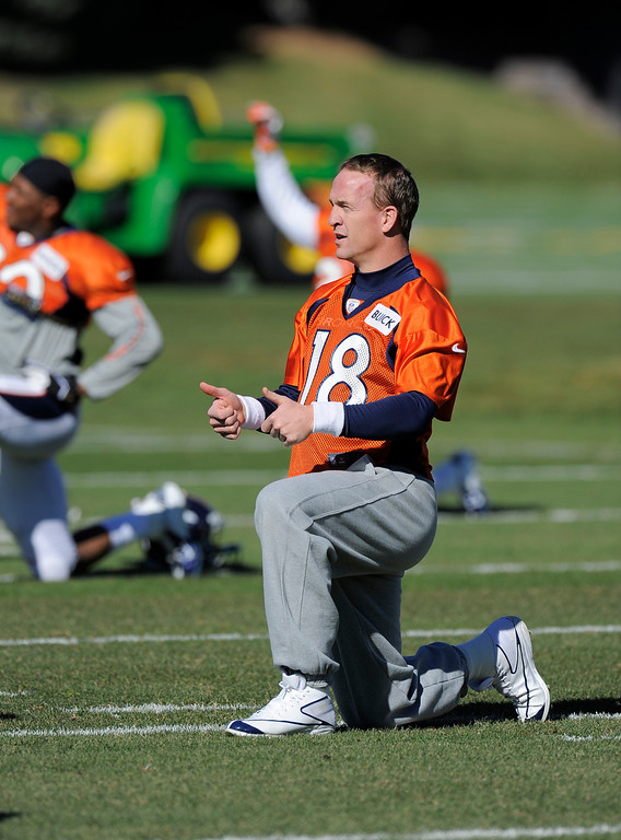 . Denver Broncos quarterback Peyton Manning (18) stretched before practice but did not do any throwing October 23, 2013 at Dove Valley. (Photo by John Leyba/The Denver Post)