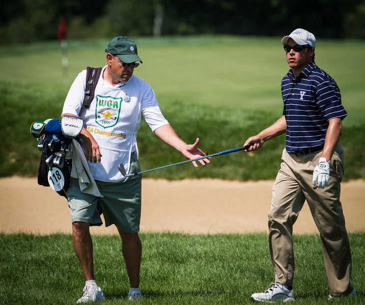 Andrew Vitt hands club to his father John who is caddying for him during the second round medal play at the 2012 Western Amateur Championship at Exmoor Country Club in Highland Park IL. on Wednesday, August 1, 2012. (WGA Photo/Charles Cherney)