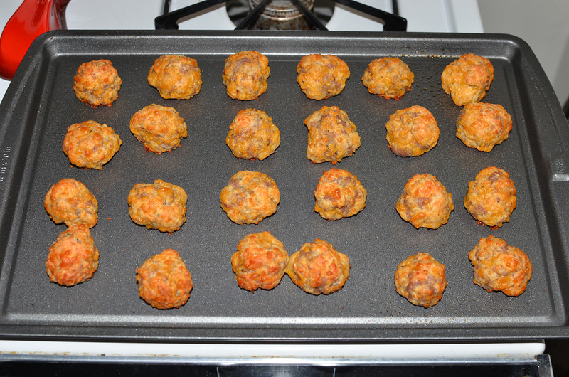Sausage cheese balls. Italian sausage w/fennel, parmigianno-reggiano and sharp cheddar cheese, oregano, Bisquick and milk. Served w/sweet chili and BBQ sauces.