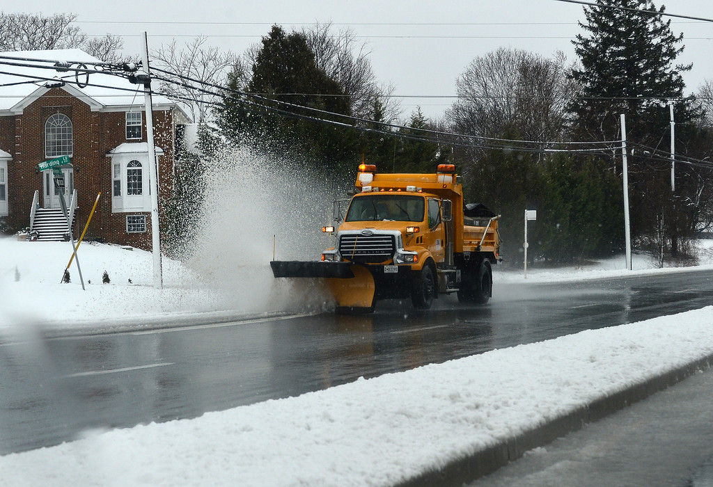 . A snow truck sweeps snow from a road in Silver Spring, Maryland, on March 6, 2013.  AFP PHOTO/Jewel SAMAD/AFP/Getty Images