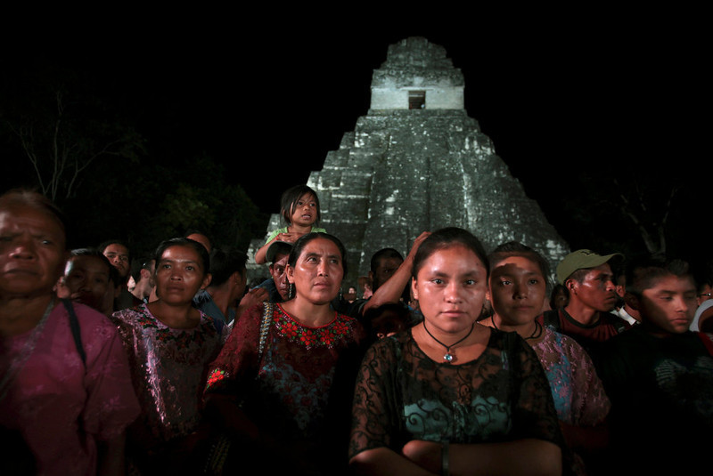 ". Aborigines ""Kekchi\"", from Coban, gather as they protest a day before the Oxlajuj Baktun celebration at the Tikal Mayan ruins in Peten, Guatemala, December 20, 2012. Indigenous activists protested outside Guatemala\'s ancient ruins of Tikal on Thursday as members of the country\'s poverty-stricken Mayan communities seek to draw international attention to their plight ahead of festivities to mark the end of the Mayan calendar. REUTERS/William Gularte"