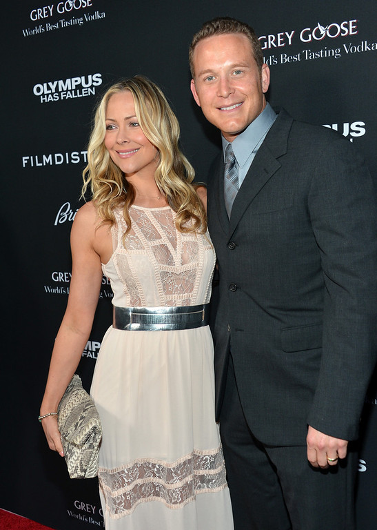 """. Cynthia Daniel (L) and actor Cole Hauser arrive at the premiere of FilmDistrict\'s \""""Olympus Has Fallen\"""" at ArcLight Cinemas Cinerama Dome on March 18, 2013 in Hollywood, California.  (Photo by Alberto E. Rodriguez/Getty Images)"""