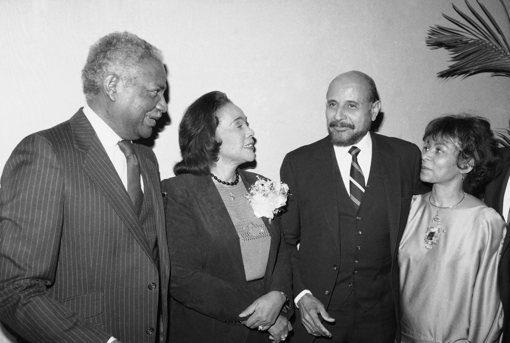 . From left to right Ossie Davis, Correta Scott King, Percy Sutton and Ruby Dee chatting during a New York Council of Minority Builders reception on Sunday, Jan. 16, 1984 at the Grand Hyatt Hotel in New York.  The Council of Minority builders presented a donation to Coretta Scott King for the Martin Luther King Center for Non-Violent Social Change. (AP Photo/Ray Stubblebine)