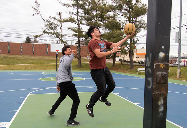 01/14/20 Wesley Bunnell | StaffrrFriends Omar Williams, L, and Chris Nieves play a game of basketball in the renovated Chesley Park on Tuesday afternoon January 14, 2019 with the park getting good reviews for all of the recent renovations including a new basketball surface.