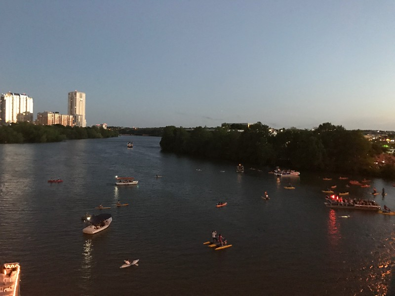 Thousands of bats look like a wispy dark cloud from the Congress Avenue bridge.
