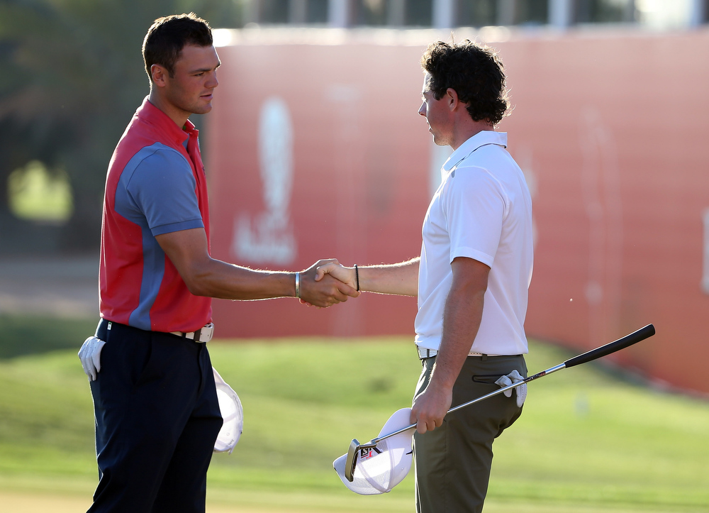 Description of . Martin Kaymer of Germany and  Rory McIlroy of Northern Ireland during the second round of the Abu Dhabi HSBC Golf Championship at the Abu Dhabi Golf Club on January 18, 2013 in Abu Dhabi, United Arab Emirates.  (Photo by Ross Kinnaird/Getty Images)