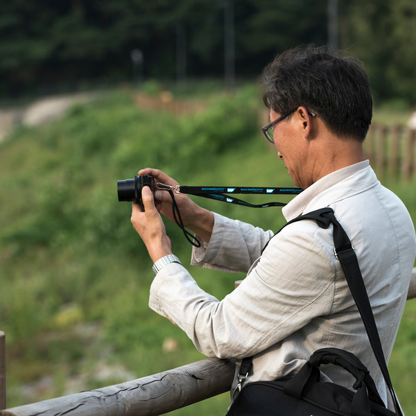 Man taking picture with camera, Seoul, South Korea