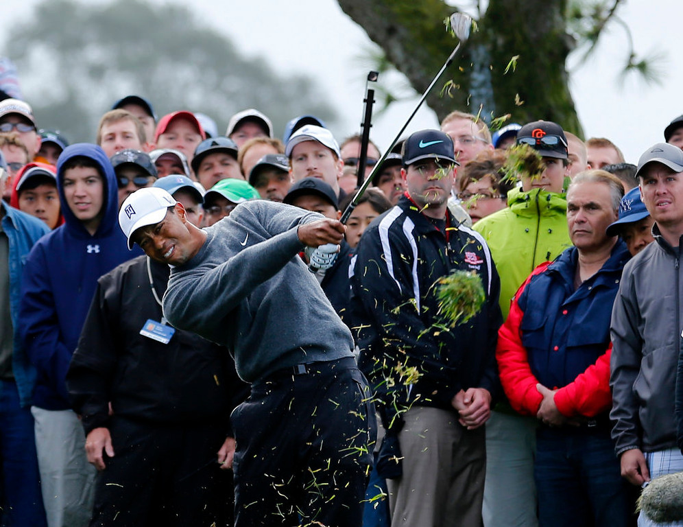 . U.S. golfer Tiger Woods hits his second shot from the rough on the 4th hole during weather delayed third round play at the Farmers Insurance Open in San Diego, California January 27, 2013.           REUTERS/Mike Blake