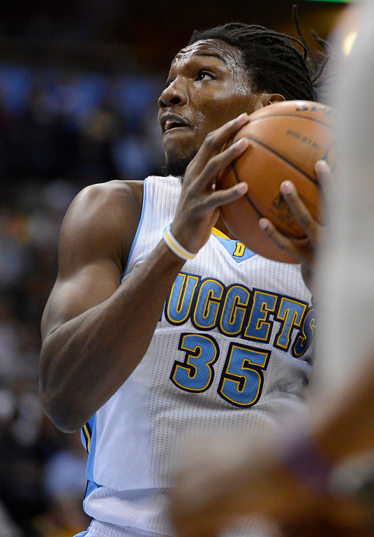 . Kenneth Faried (35) of the Denver Nuggets goes up for a shot against the Atlanta Hawks March 4,  2013 at Pepsi Center. (Photo By John Leyba/The Denver Post)