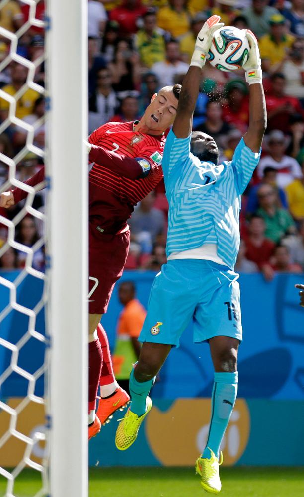 . Portugal\'s Cristiano Ronaldo, left, tries a header as Ghana\'s goalkeeper Fatawu Dauda grabs the ball during the group G World Cup soccer match between Portugal and Ghana at the Estadio Nacional in Brasilia, Brazil, Thursday, June 26, 2014. (AP Photo/Dolores Ochoa)