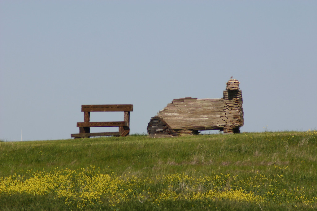 . A wooden river otter, made from scrap lumber, looks out over the beaver pond. (Joan Morris/Mercury News)