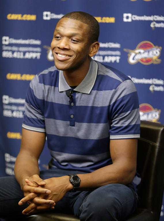 . Cleveland Cavaliers\' James Jones answers questions at an NBA basketball news conference Wednesday, Aug. 6, 2014, in Independence, Ohio. Mike Miller and Jones came to Cleveland to help LeBron James win an NBA title. They hope Ray Allen joins them. Jones, who won two NBA titles as James\' teammate in Miami, said he recently spent time with Allen in Connecticut. Jones said he would love to play with Allen again, but doesn\'t know if the 39-year-old will play another season.(AP Photo/Tony Dejak)