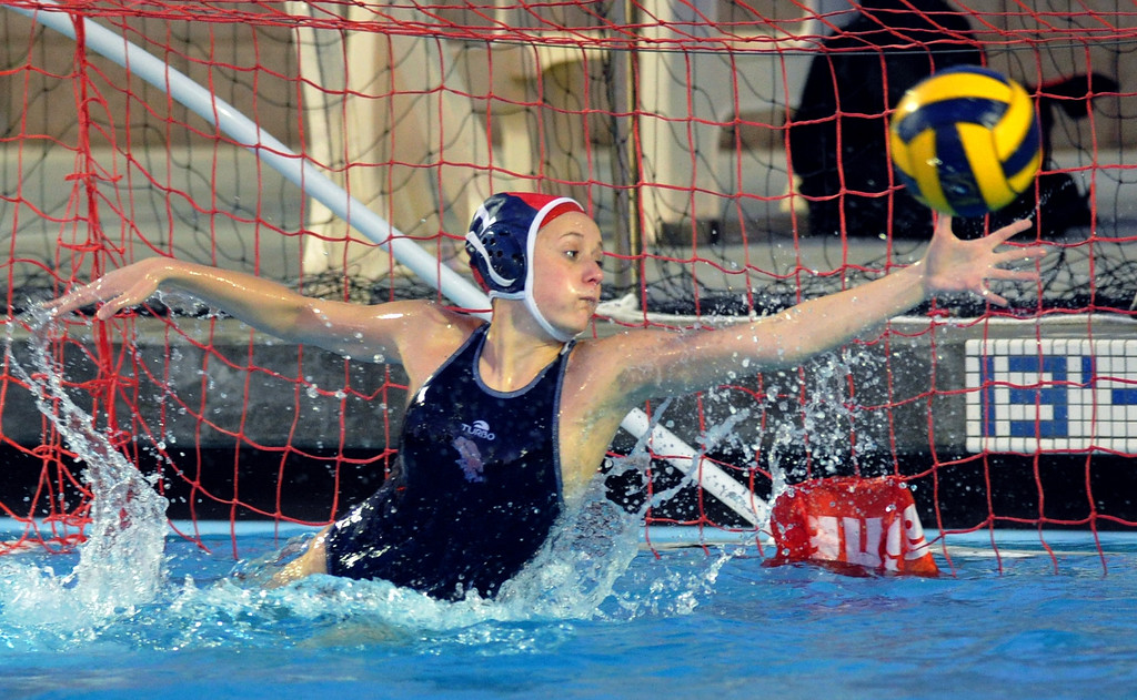 . Crescenta Valley goalie blocks a shot as they play Redlands East Valley in the Southern Section Div. V semifinals girls water polo game at Whittier College\'s Lillian Slade Aquatics Center on Wednesday February 20, 2013. Crescenta Valley beat Redlands East Valley 14-4. (Staff photo by Keith Durflinger)