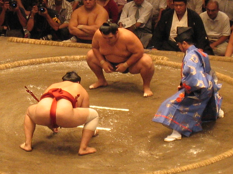 Sumo wrestlers getting ready to fight.