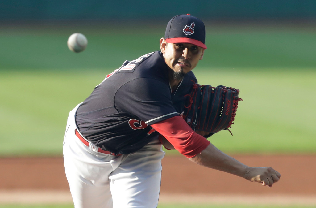 . Cleveland Indians starting pitcher Carlos Carrasco watches a throw during the first inning of the team\'s baseball game against the Cincinnati Reds, Wednesday, July 11, 2018, in Cleveland. (AP Photo/Tony Dejak)