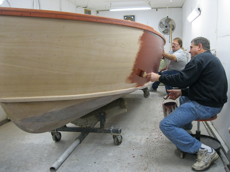 Applying stain to the port side.