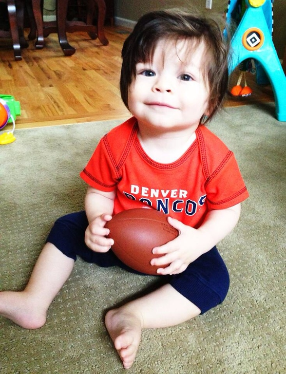 . Gavin is ready to cheer on his favorite team, he even has his own football! Go Bronco\'s!