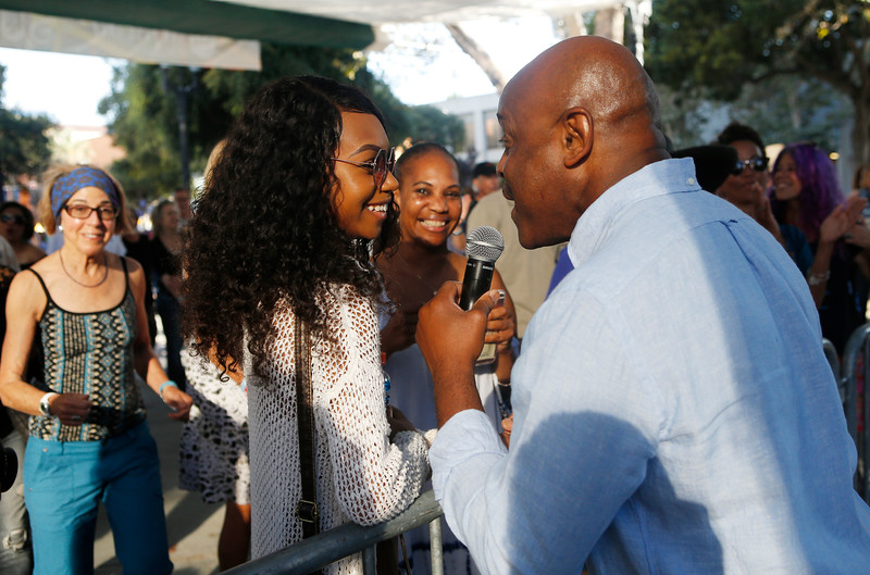 Tony Lindsay sings up close to Jayde Allen, of San Jose, during the San Jose Jazz Festival at the Plaza de César Chavez in San Jose, Calif., on Friday, Aug. 12, 2016. (Jim Gensheimer/Bay Area News Group)