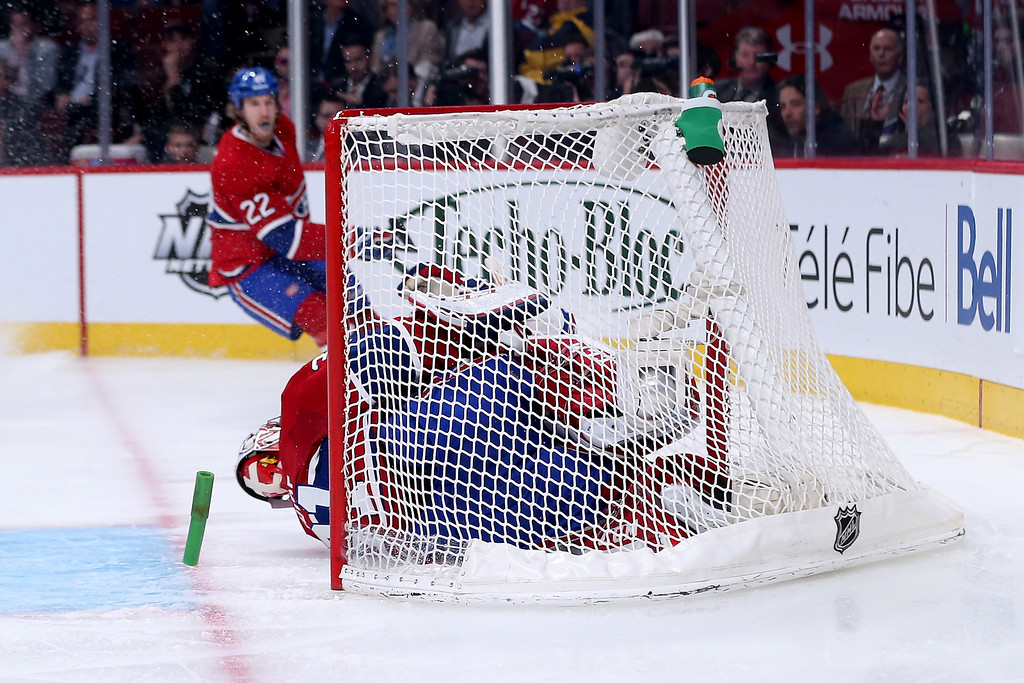 . MONTREAL, QC - MAY 17:  Chris Kreider #20 of the New York Rangers crashes into Carey Price #31 of the Montreal Canadiens and dislodges the net in the second period in Game One of the Eastern Conference Finals of the 2014 NHL Stanley Cup Playoffs at the Bell Centre on May 17, 2014 in Montreal, Canada.  (Photo by Bruce Bennett/Getty Images)