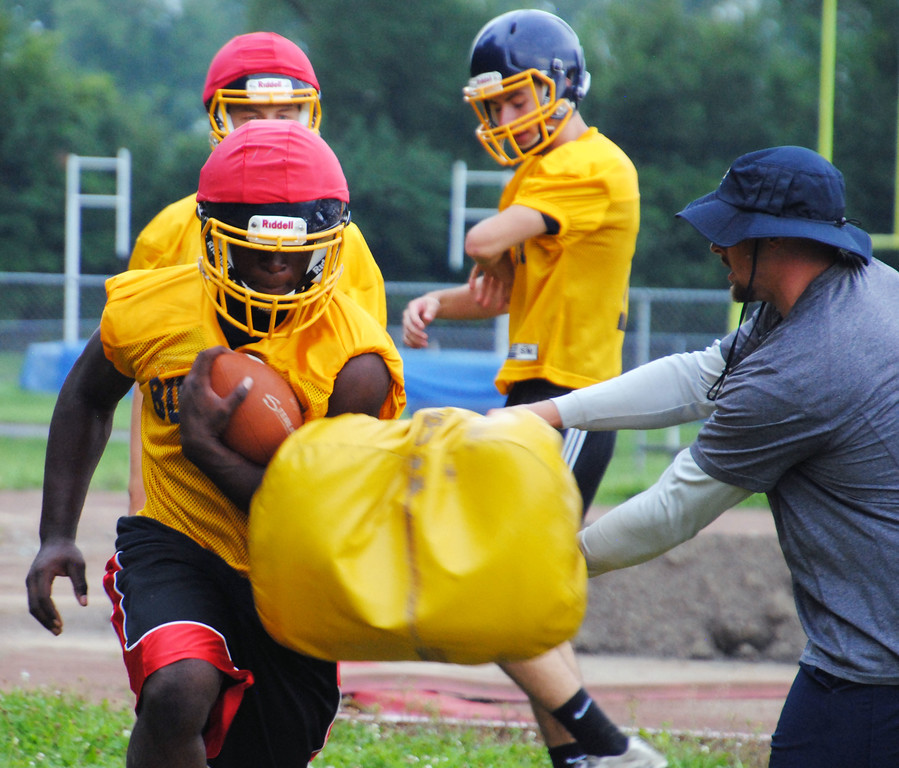 . Jon Behm - The Morning Journal<br> Olmsted Falls running back Devontae Boyd runs through a pad during Olmsted Falls\' first day of football practice on July 30.