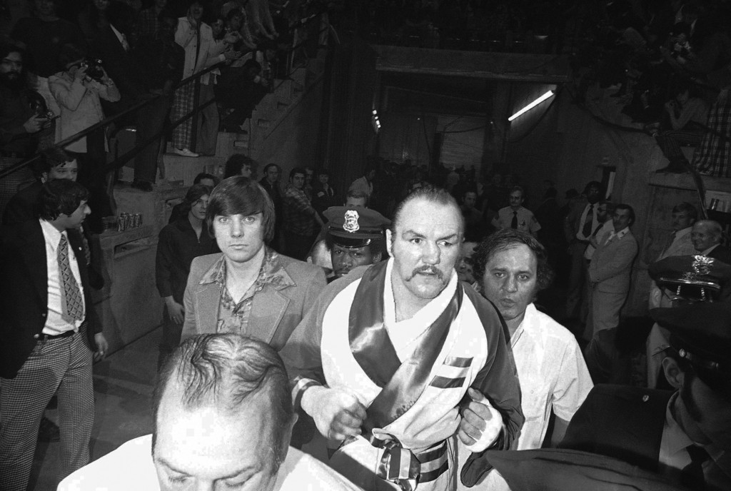 . Challenger Chuck Wepner clenches his fists as he walks to ring to meet heavyweight champion Muhammad Ali in scheduled 15-round title bout at the Cleveland Coliseum in Richfield, Ohio, Monday, March 24, 1975. (AP Photo/Gene Puskar)