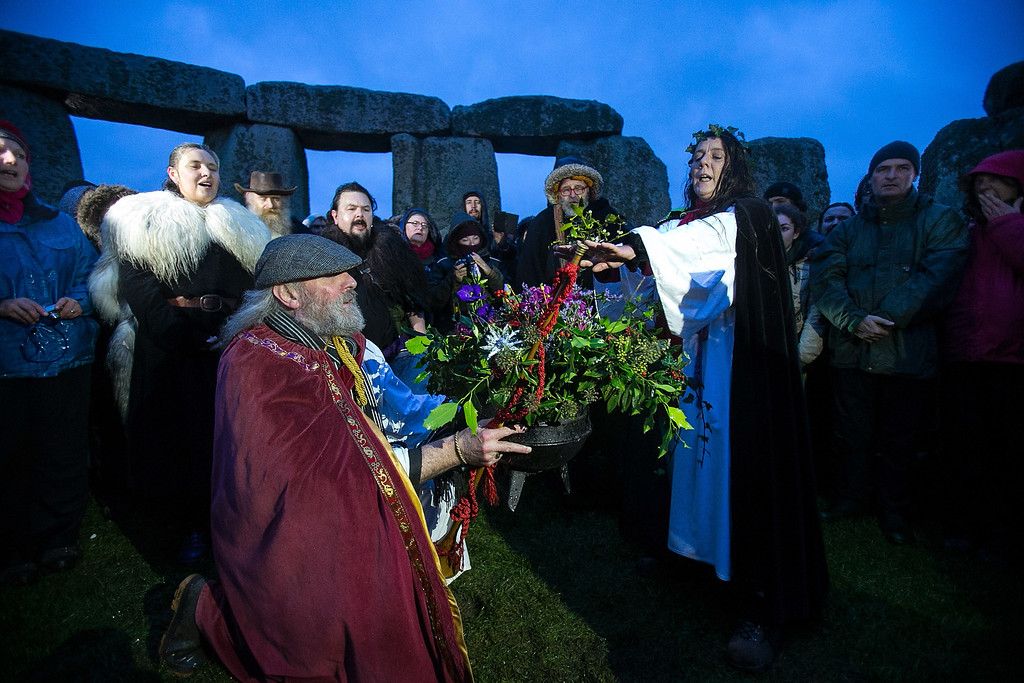 . Rollo Maughfling, Archdruid of Stonehenge & Britain, (kneelling) conducts a ceremony as druids, pagans and revelers gather, hoping to see the sun rise as they take part in a winter solstice ceremony at Stonehenge on December 21, 2013 in Wiltshire, England.   (Photo by Matt Cardy/Getty Images)