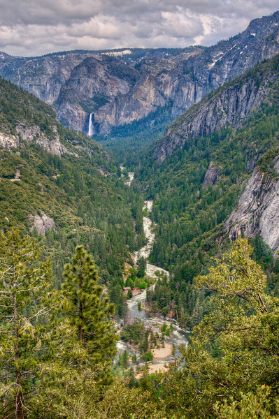 A little bit past the previous turn-out is another one, which gives you views of Bridalveil Falls and the Merced River. I always pull over here too!