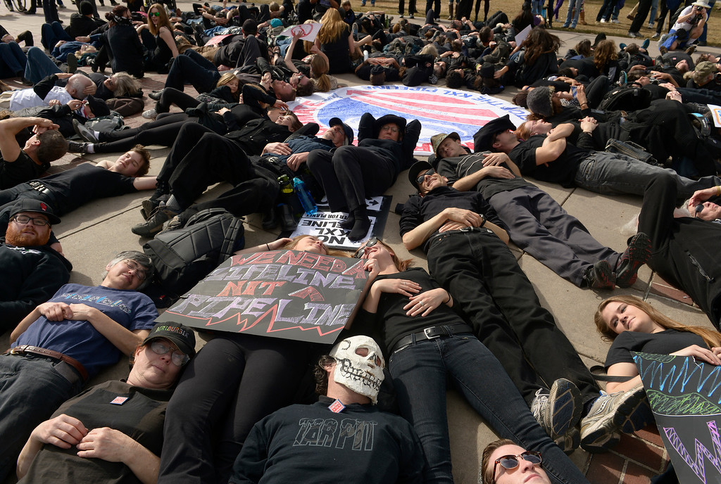 . DENVER, CO- FEBRUARY 17:   All of the protestors wore black and lay down in Civic Center park to act as a human oil spill during the rally.    A few hundred people from a coalition of students, faith-based organizations, indigenous, political, and environmental groups marched from the Denver Auraria campus and ended in a rally at Civic Center Park on February 17th, 2013.  The march, called the #ForwardOnClimate Solidarity March and rally, organized by the Sierra Club, 350.org and GoFossilFree.org,  coincided with tens of thousands of protestors, who converged on Washington, DC for the largest climate rally in history. Denver was one of 18 cities hosting major actions to show solidarity with the DC event.    (Photo By Helen H. Richardson/ The Denver Post)