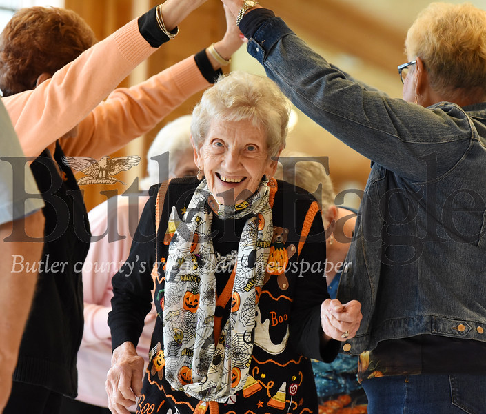 Harold Aughton/Butler Eagle: Jean Hickey, 91, of Butler took part in the square dance at the fall senior festival at YMCA CAMP Kon-O-Kwee.