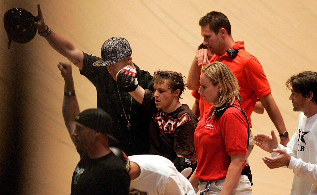 . Jake Brown, center, walks away after taking a 50-foot plunge into the skateboarding abyss after completing the very elusive 720 degree spin during X Games 13 at Staples Center in Los Angeles California on August 2, 2007.  He remained on the ground for about ten minutes while medical personnel tended to him. (SGVN/Staff Photo by Raul Roa/Sports)