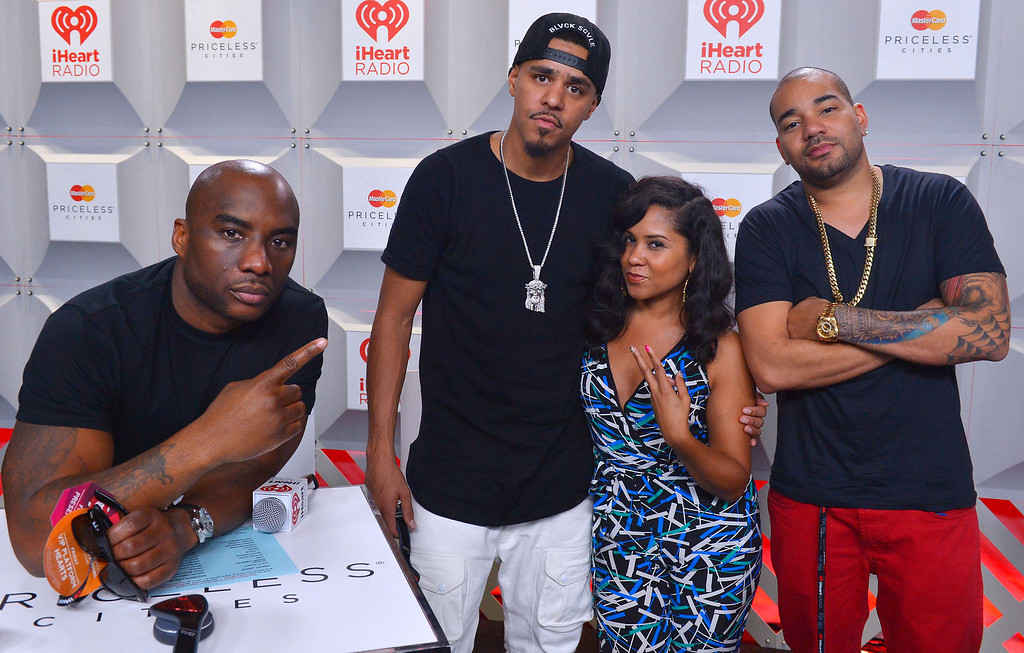 . (L-R)  Charlamagne tha God, J. Cole, Angela Yee, and Dj Envy attend the iHeartRadio Music Festival at the MGM Grand Garden Arena on September 20, 2013 in Las Vegas, Nevada.  (Photo by Bryan Steffy/Getty Images for Clear Channel)