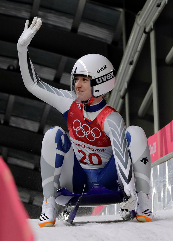. Aileen Christina Frisch of Korea waves in the finish area after her second run during the women\'s luge competition at the 2018 Winter Olympics in Pyeongchang, South Korea, Monday, Feb. 12, 2018. (AP Photo/Wong Maye-E)