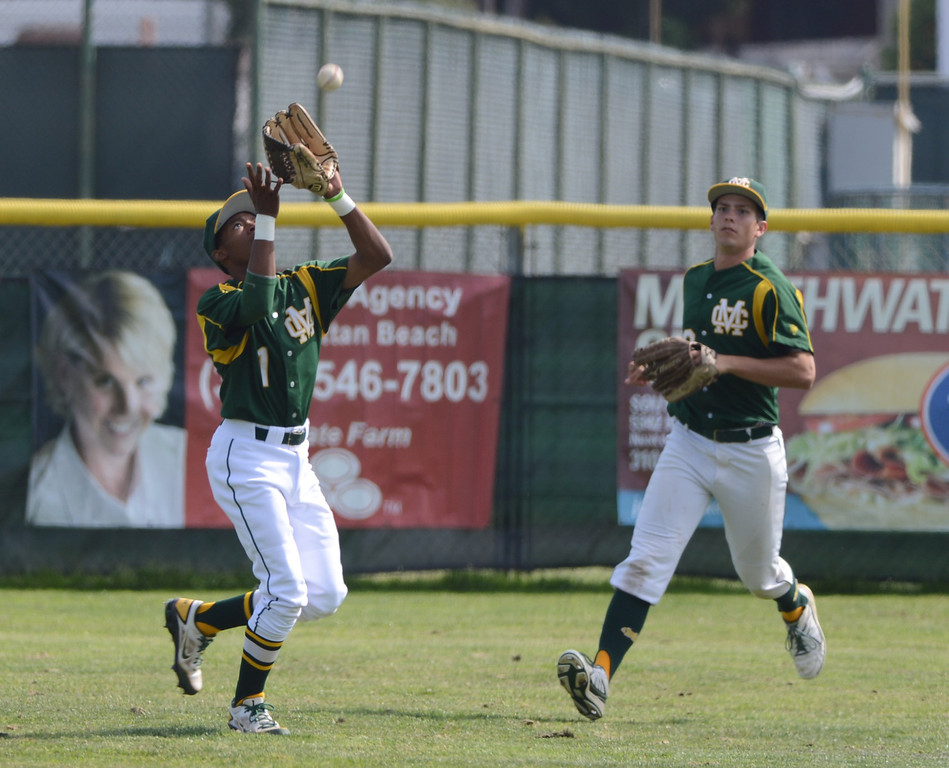 . Mira Costa centerfielder Kenyon Allen makes a catch. Mira Costa defeated Westchester 2-1 at home in boy\'s baseball.  Photo by Brad Graverson 3-26-13